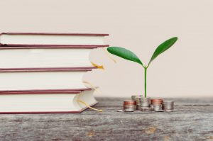 books, coins, green plant; save money